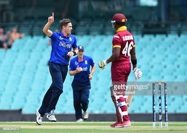 Chris Woakes of England celebrates after taking the wicket of Darren Bravo of West Indies during the ICC Cricket World Cup warm up match between...