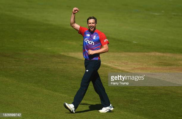 Chris Woakes of England celebrates after taking the wicket of Kusal Perera of Sri Lanka during the T20 International Series Third T20I match between...
