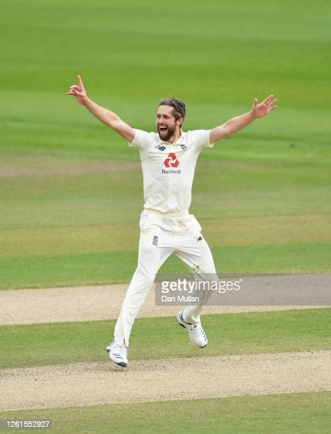 Chris Woakes of England celebrates after taking the wicket of Rahkeem Cornwall of West Indies for his fifth wicket of the innings during Day Five of...
