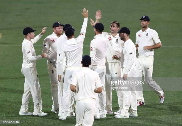 Chris Woakes of England celebrates after taking the wicket of Tim Paine of CA XI during day three of the four day tour match between Cricket...