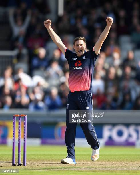 Chris Woakes of England celebrates dismissing Chris Gayle of the West Indies during the 1st Royal London One Day International match between England...