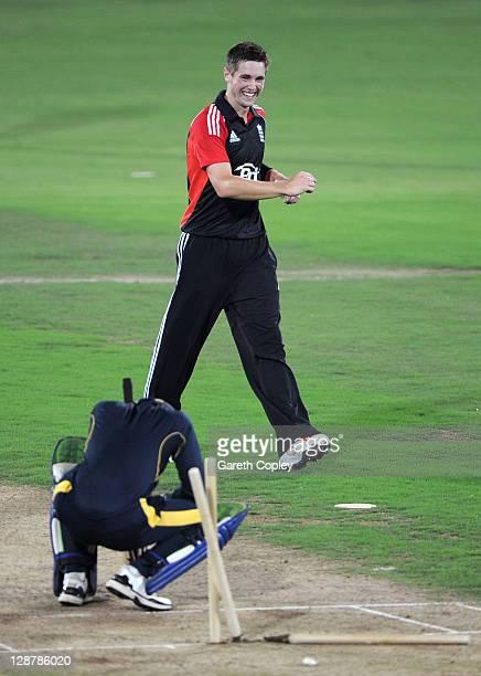 Chris Woakes of England celebrates dismissing Ibrahim Khaleel of Hyderabad Cricket Association XI during the tour match between England and Hyderabad...