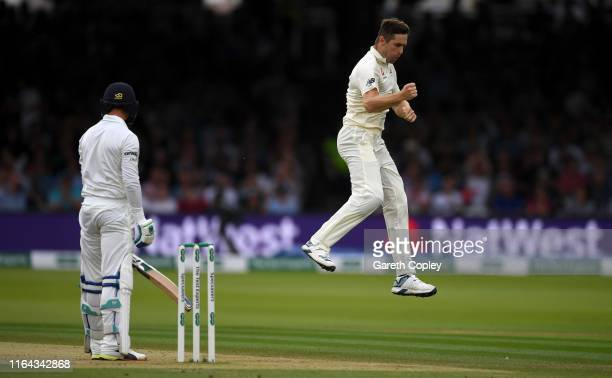 Chris Woakes of England celebrates dismissing James McCollum of Ireland during day three of the Specsavers Test Match between England and Ireland at...