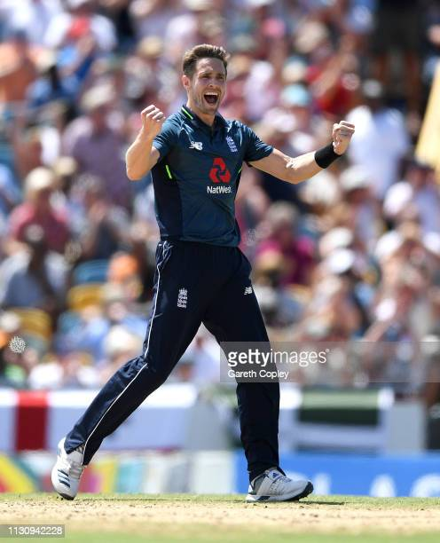 Chris Woakes of England celebrates dismissing John Campbell of the West Indies during the 1st One Day International match between the West Indies and...