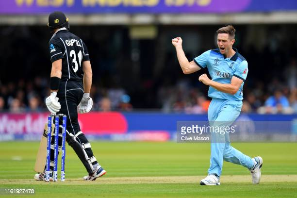 Chris Woakes of England celebrates dismissing Martin Guptill of New Zealand during the Final of the ICC Cricket World Cup 2019 between New Zealand...