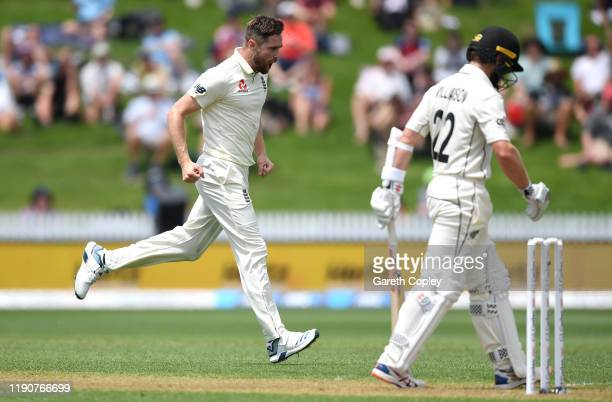 Chris Woakes of England celebrates dismissing New Zealand captain Kane Williamson during day 1 of the second Test match between New Zealand and...