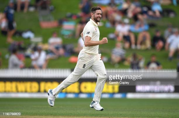 Chris Woakes of England celebrates dismissing Ross Taylor of New Zealand during day 1 of the second Test match between New Zealand and England at...
