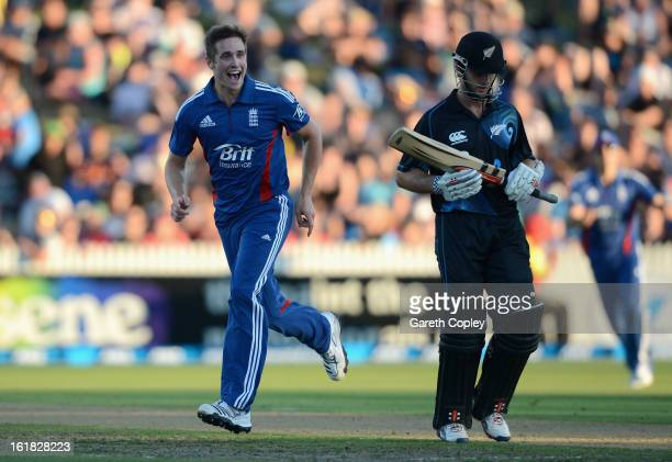 Chris Woakes of England celebrates dismissing Ross Taylor of New Zealand during the first match of the one day international series between New...