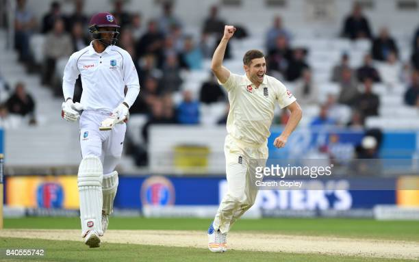 Chris Woakes of England celebrates dismissing Roston Chase of the West Indies score runs during day five of the 2nd Investec Test between England and...