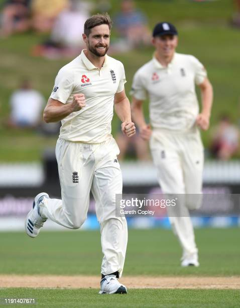 Chris Woakes of England celebrates dismissing Tom Latham of New Zealand during day 4 of the second Test match between New Zealand and England at...