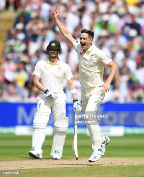 Chris Woakes of England celebrates dismissing Usman Khawaja of Australia during day one of the 1st Specsavers Ashes Test between England and...