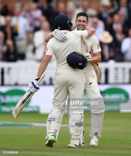 Chris Woakes of England celebrates reaching his century with teammate Jonathan Bairstow during day three of the 2nd Specsavers Test between England...