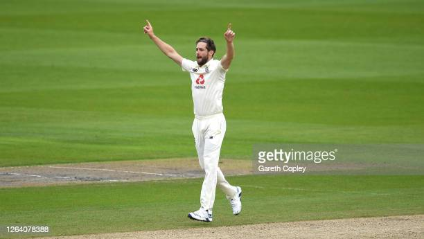 Chris Woakes of England celebrates taking the wicket of Azhar Ali of Pakistan during Day One of the 1st #RaiseTheBat Test Match between England and...