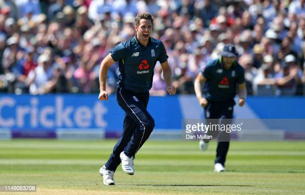 Chris Woakes of England celebrates taking the wicket of Babar Azam of Pakistan during the 3rd Royal London One Day International between England and...