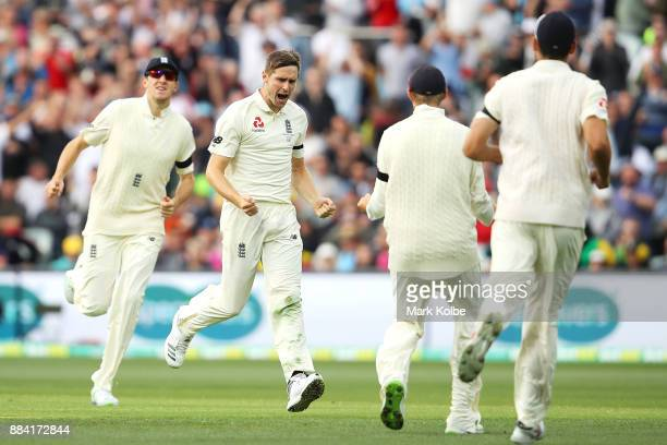 Chris Woakes of England celebrates taking the wicket of David Warner of Australia during day one of the Second Test match during the 2017/18 Ashes...