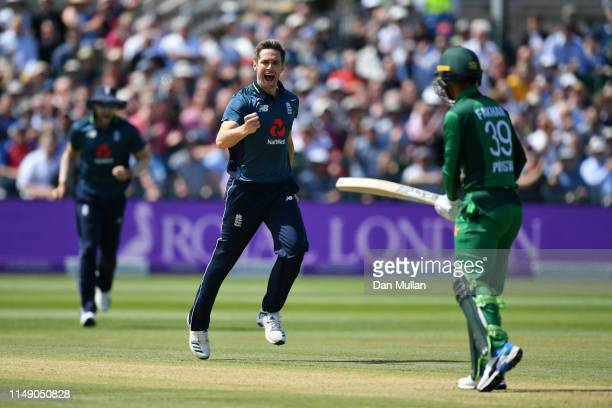 Chris Woakes of England celebrates taking the wicket of Fakhar Zaman of Pakistan during the 3rd Royal London One Day International between England...