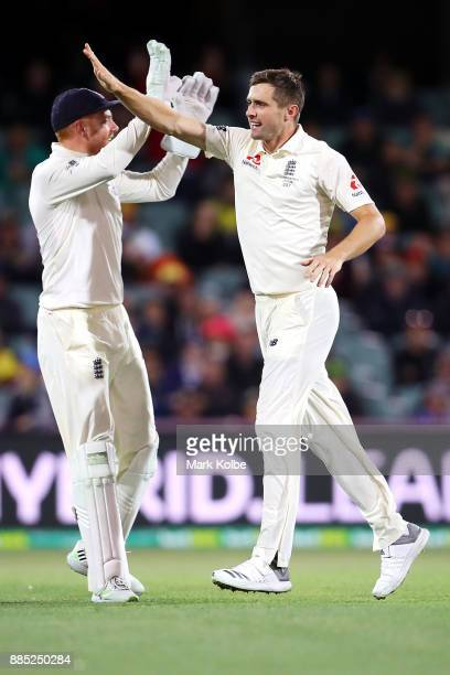 Chris Woakes of England celebrates taking the wicket of Steve Smith of Australia during day three of the Second Test match during the 2017/18 Ashes...