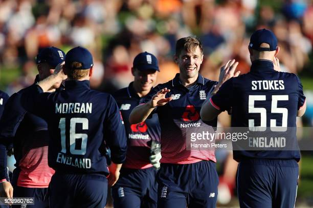 Chris Woakes of England celebrates the wicket of Martin Guptill during game one in the One Day International series between New Zealand and England...
