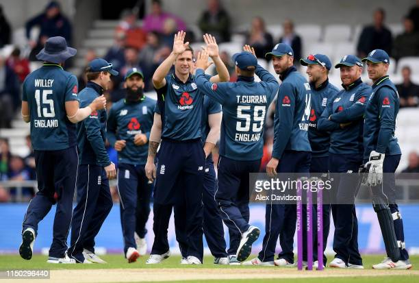Chris Woakes of England celebrates the wicket of Mohammad Hafeez of Pakistan with his teammates during the 5th One Day International between England...
