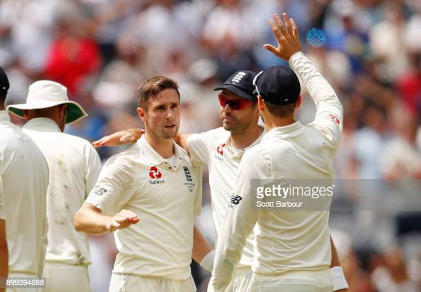 Chris Woakes of England celebrates with his teammates after dismissing Cameron Bancroft of Australia during day four of the Fourth Test Match in the...