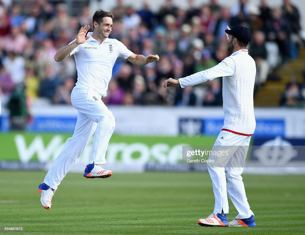 Chris Woakes of England celebrates with James Vince after dismissing Kusal Mendis of Sri Lanka during day two of the 2nd Investec Test match between England and Sri Lanka at Emirates Durham ICG on May 28, 2016 in Chester-le-Street, United Kingdom.
