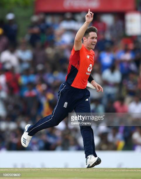 Chris Woakes of England celebrates with Liam Dawson after dismissing Dasun Shanaka of Sri Lanka during the 2nd One Day International match between...