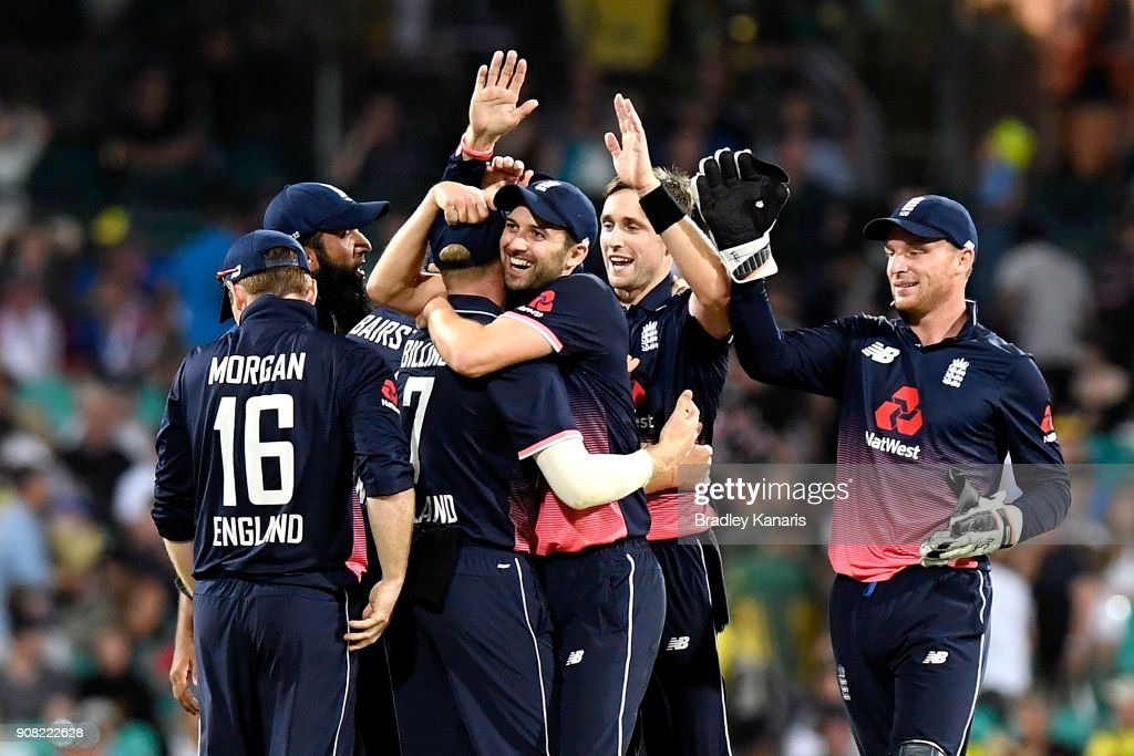 Chris Woakes of England celebrates with team mates after taking the wicket of Marcus Stoinis of Australia during game three of the One Day International series between Australia and England at Sydney Cricket Ground on January 21, 2018 in Sydney, Australia.