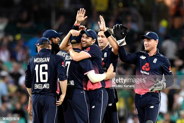 Chris Woakes of England celebrates with team mates after taking the wicket of Marcus Stoinis of Australia during game three of the One Day...