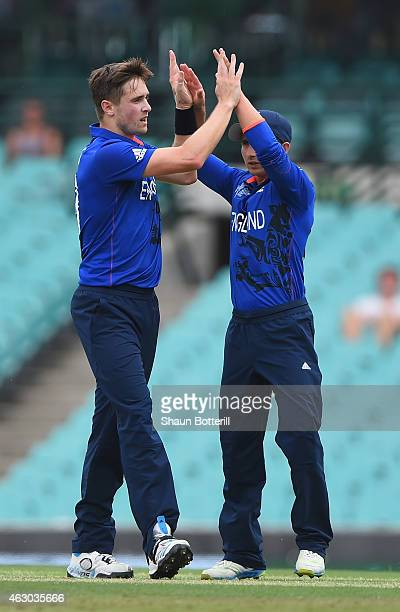 Chris Woakes of England celebrates with teammate James Taylor after taking the wicket of Dwayne Smith of West Indies during the ICC Cricket World Cup...