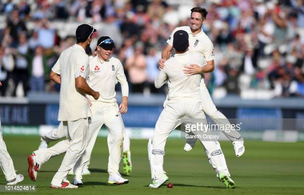 Chris Woakes of England celebrates with teammates after dismissing India captain Virat Kohli during day two of the 2nd Specsavers Test between...