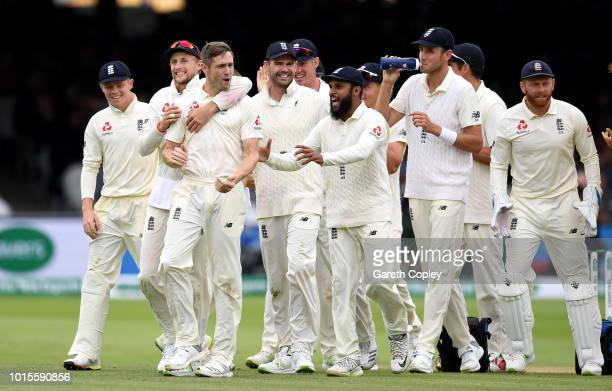 Chris Woakes of England celebrates with teammates after dismissing Hardik Pandya of India during day four of the 2nd Specsavers Test between England...