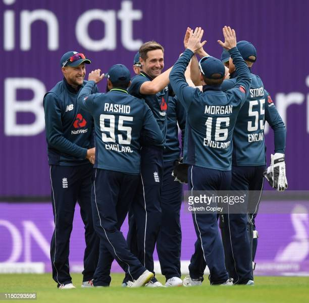 Chris Woakes of England celebrates with teammates after dismissing Fakhar Zaman of Pakistan during the 5th One Day International between England and...