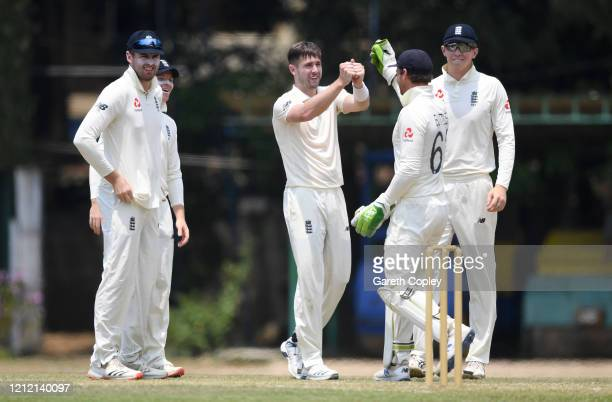 Chris Woakes of England celebrates with teammates after dismissing Sadeera Samarawickrama of SLC Board President's XI during the tour match between...