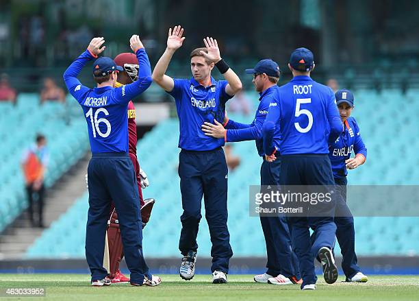 Chris Woakes of England celebrates with teammates after taking the wicket of Darren Bravo of West Indies during the ICC Cricket World Cup warm up...