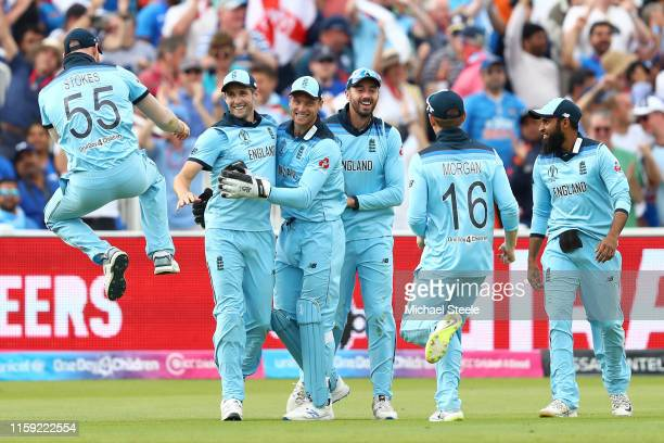 Chris Woakes of England celebratews with Jos Buttler and Ben Stokes after diving to take a spectacular catch to dismiss Rishhabh Pant of India off...