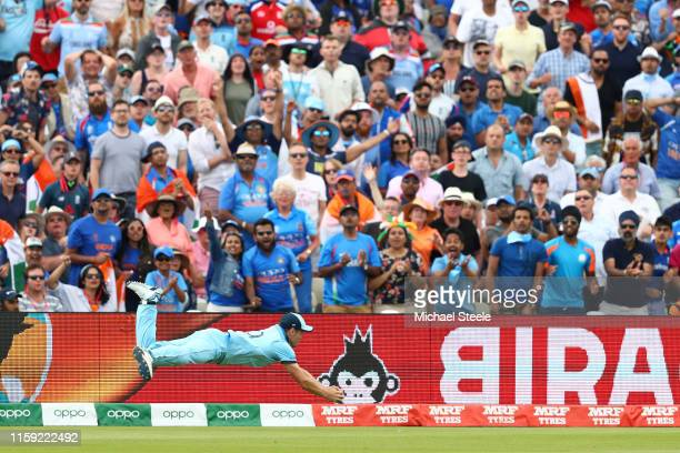 Chris Woakes of England dives to take a spectacular catch to dismiss Rishhabh Pant of India off the bowling of Liam Plunkett during the Group Stage...