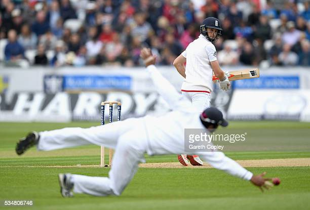 Chris Woakes of England guides the ball past Dimuth Karunaratne of Sri Lanka during day two of the 2nd Investec Test match between England and Sri...