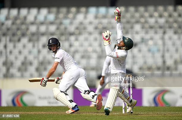 Chris Woakes of England hits past Bangladesh wicketkeeper Mushfiqur Rahim during the second day of the 2nd Test match between Bangladesh and England...