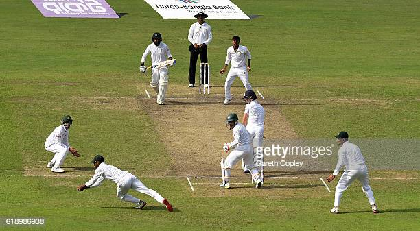 Chris Woakes of England is caught out by Shuvagata Hom of Bangladesh from the bowling of Mehedi Hasan during the second day of the 2nd Test match...