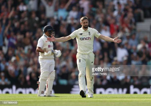 Chris Woakes of England is congratulated after Moeen Ali of England catches out Rishabh Pant of India during day one at The Kia Oval on September 02,...