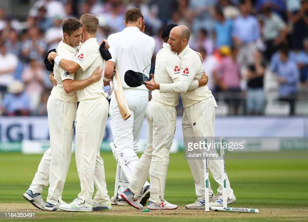 Chris Woakes of England is congratulated at the end of the match during day three of the Specsavers Test Match between England and Ireland at Lord's...