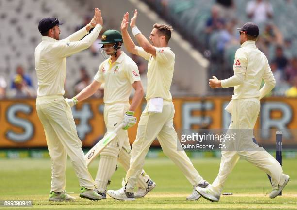 Chris Woakes of England is congratulated by team mates after taking the wicket of Cameron Bancroft of Australia during day four of the Fourth Test...