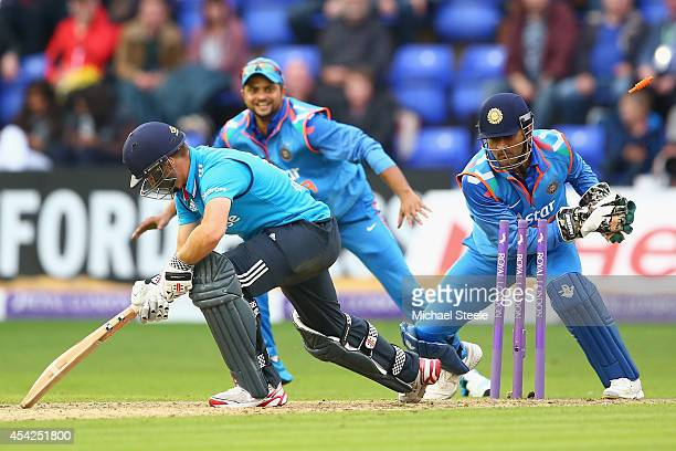 Chris Woakes of England is stumped by MS Dhoni of India off the bowling of Ravindra Jadeja during the second Royal London OneDay Series match between...