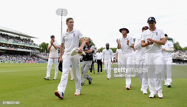 Chris Woakes of England leads his team from the field on stumps on day three of the 1st Investec Test between England and Pakistan at Lord's Cricket...