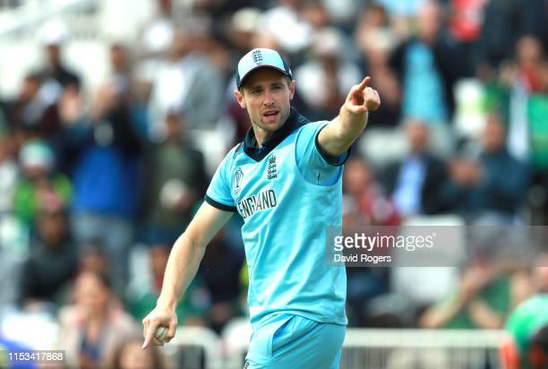 Chris Woakes of England points to the Pakistan supporters after catching Imanulhaq during the Group Stage match of the ICC Cricket World Cup 2019...