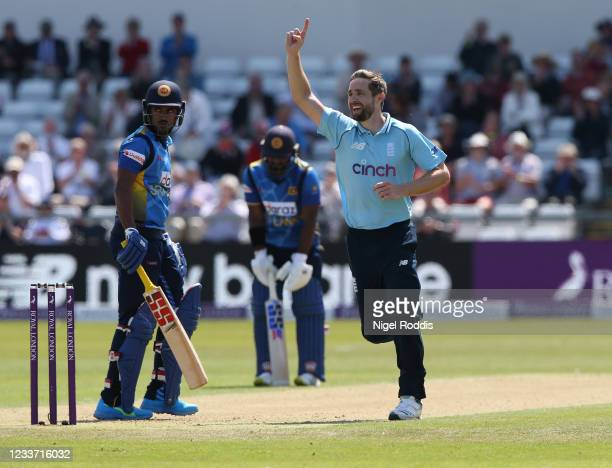Chris Woakes of England reacts after taking the wicket of Dhananjaya Lakshan of Sri Lanka during the 1st ODI cricket match between England and Sri...