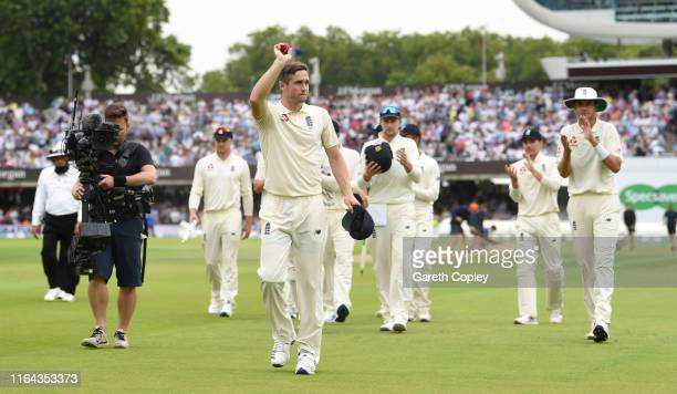 Chris Woakes of England salutes the crowd as he leaves the field after taking six wickets during the Specsavers Test Match between England and...