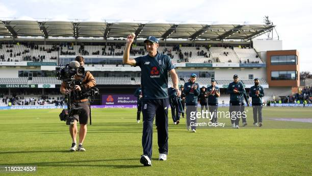 Chris Woakes of England salutes the crowd as he leaves the field after picking up his five wicket haul during the 5th One Day International between...