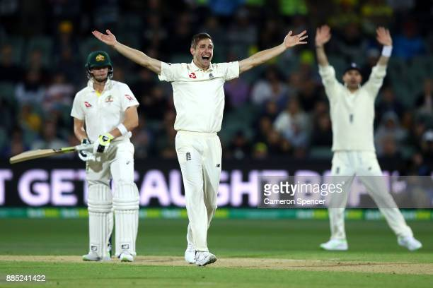 Chris Woakes of England successfully appeals for lbw to dismiss Steve Smith of Australia during day three of the Second Test match during the 2017/18...