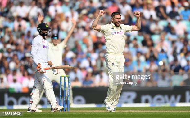 Chris Woakes of England successfully appeals for the wicket of Ravindra Jadeja of India during day four of the Fourth LV= Insurance Test Match...